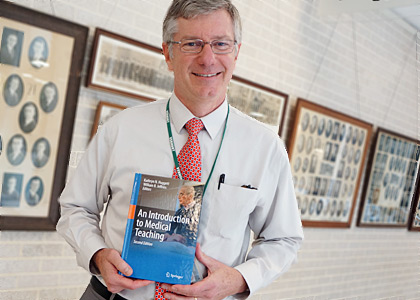 William Jeffries, Ph.D., holding his book.