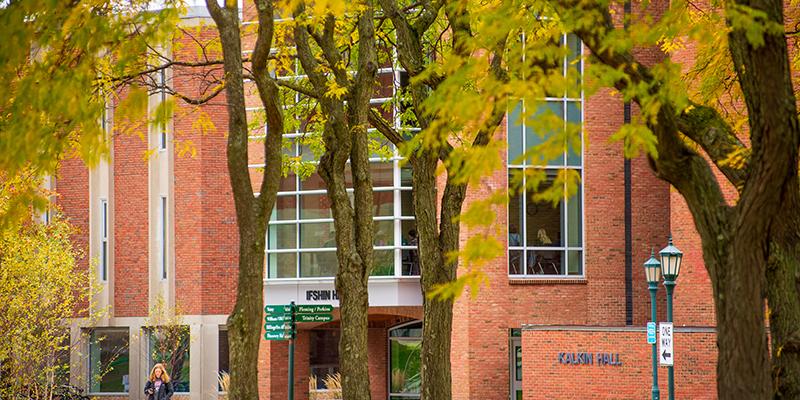 Grossman School of Business seen through the trees