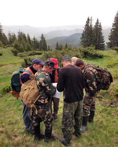 Final huddle to review maps before heading out to sample the lost valley of old-growth in Verkkovynishi National Nature Park, Ukraine. Photo Credit: Sarah Ford.