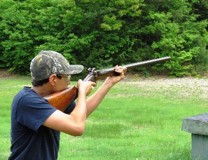 Boy aiming muzzleloader
