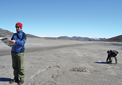 Gathering sediment samples from the Watson River bed in Greenland.
