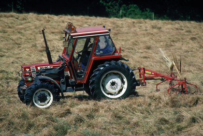 tractor working in a hay field