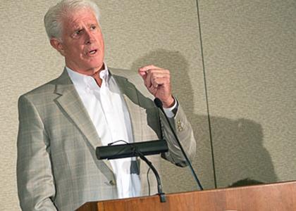 Rich Tarrant speaking at podium