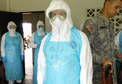 Associate Professor of Medicine Majid Sadigh, M.D., in full protective gear at the clinic in Liberia where he treated Ebola patients.