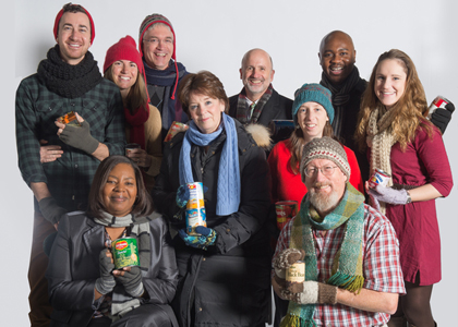 UVM staff with hats, scarves, mittens, food donations