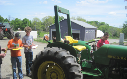 students with tractor