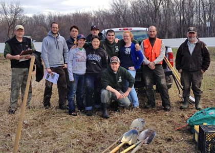 Student Wildlife & Fisheries Society plants trees with US Fish & Wildlife Service at Mississquoi Wildlife Refuge.