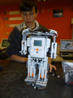 boy working on robot