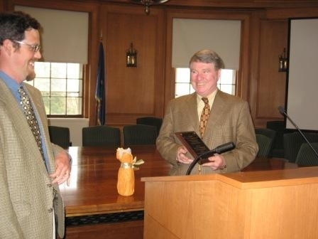 Prof. McKenna receives award from current AIS Director Prof. Luis Vivanco May 7. 2009