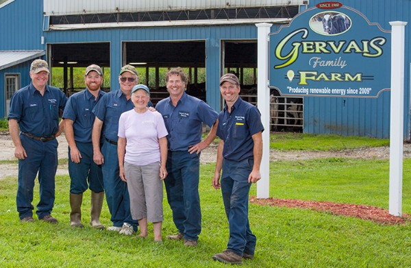 The Gervais Family of the Gervais Family Farm stand by their farm.