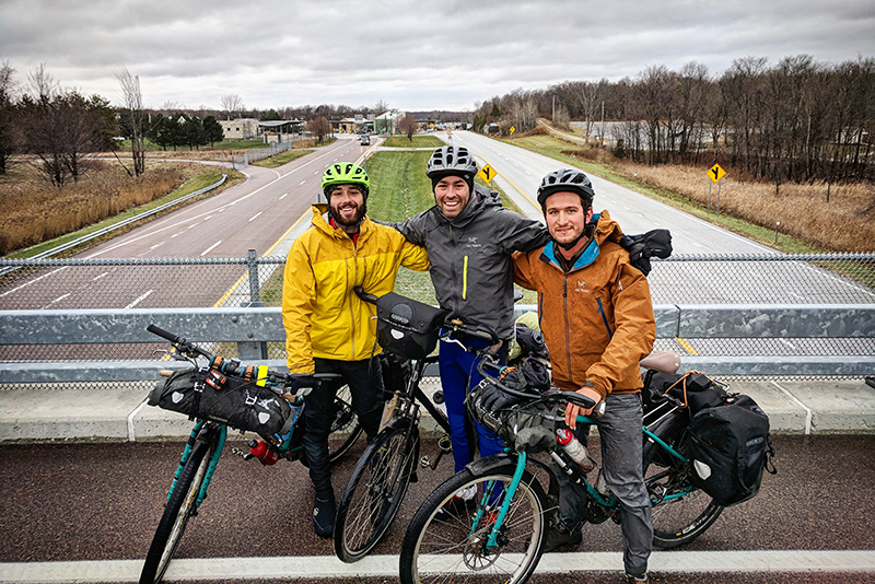our three bikers on a highway overpass at the ending spot, northern Vermont