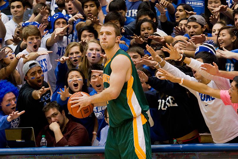 Crowd of Duke fans surrounds UVM basketball player