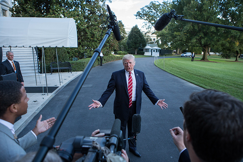 President Trump talks to reporters on White House Lawn
