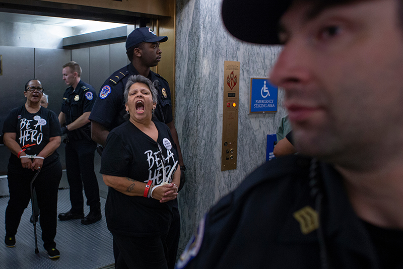 Protesters are led by police at Kavanaugh hearings