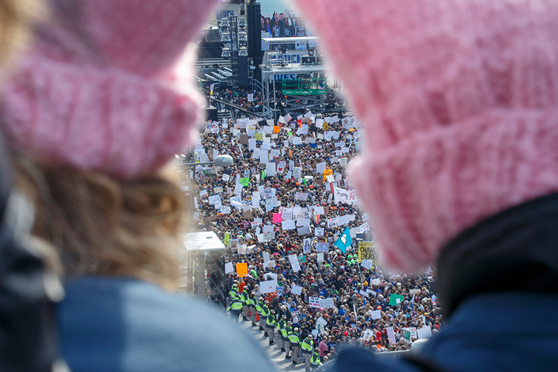 March for our Lives crowd seen between two pink hats