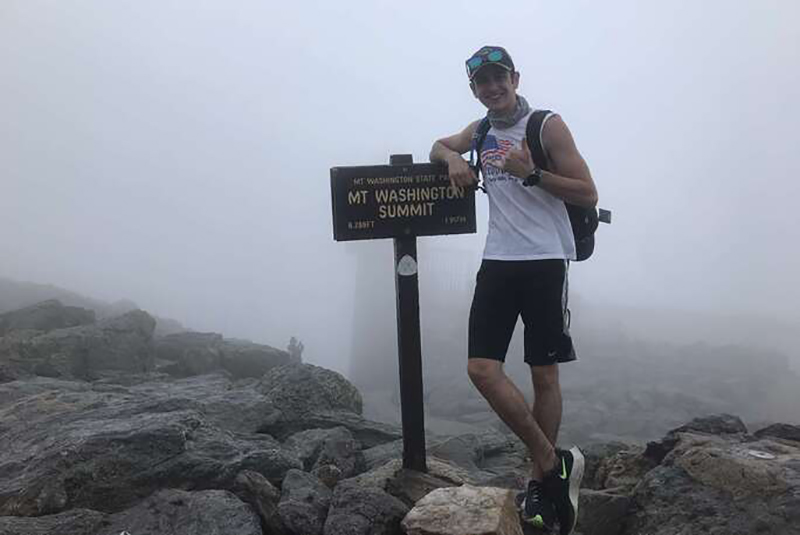 Cole Royer at the summit of Mount Washington