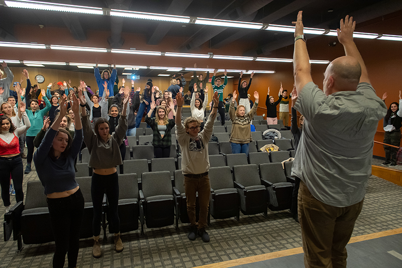 Theatre and dance professor Paul Besaw guides the class in a sequence of movements for a discussion about pattern and improvisation.