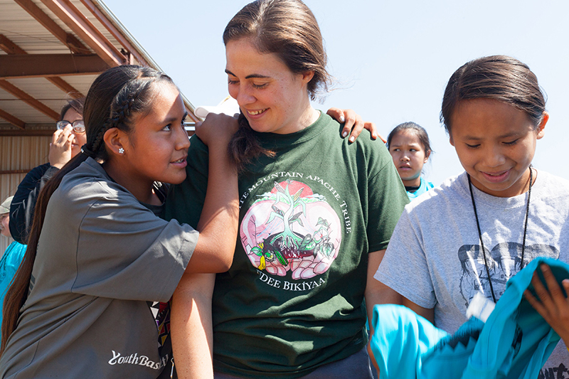 Emily Maheux and two White Mountain Apache children at Farm Camp.