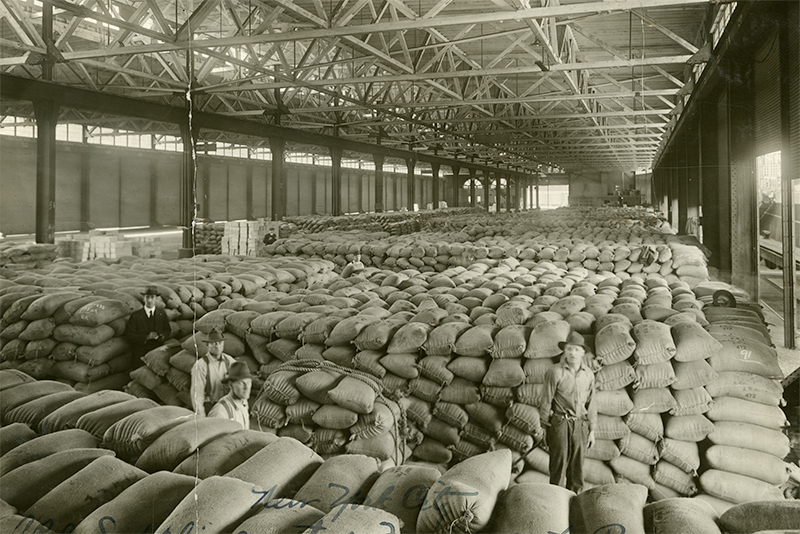 Thousands of bags of American grain stacked in a warehouse in the early 1920s.