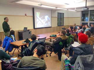 Forrest Hammond, bear biologist for Vermont Fish and Wildlife, gives a presentation to the UVM Student Wildlife and Fisheries Society on bear management.