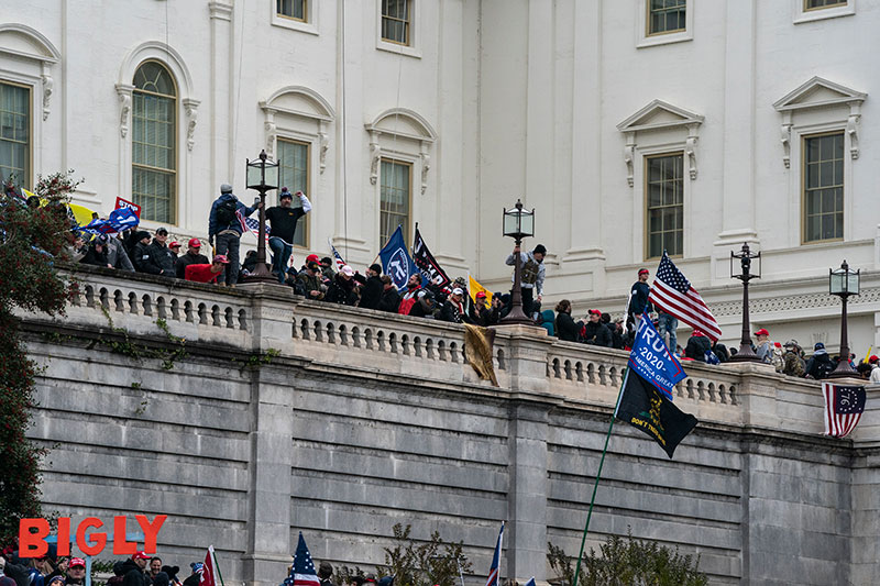 Protestors storm the west balcony of the U.S. Capitol.