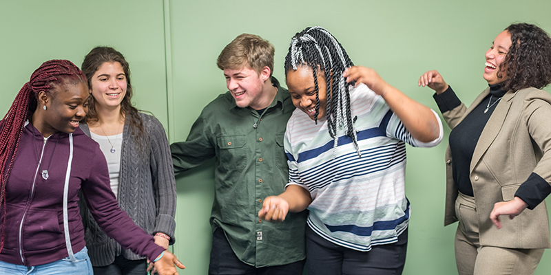 Five students in the NSBE laugh together
