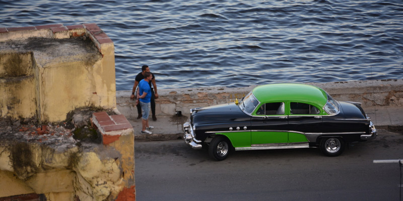 A Vintage car on the waterfront of Havana, Cuba