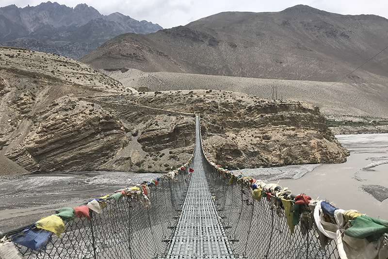 Prayer flags on a bridge, Mustang, Nepal