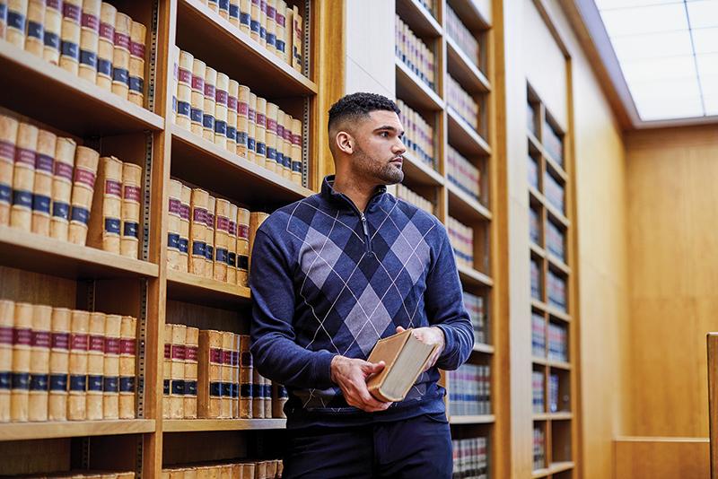 Luke Apfeld in law library
