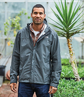 John Austin in a green house