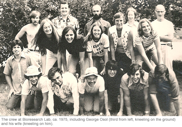 The crew at Bioresearch Lab, ca. 1975, including George Osol (third from left, kneeling on the ground) and his wife (kneeling on him).