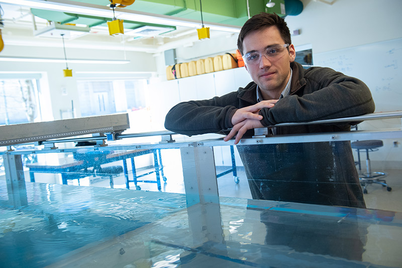 Christian Boisvert by the water tank in the wet lab in Votey