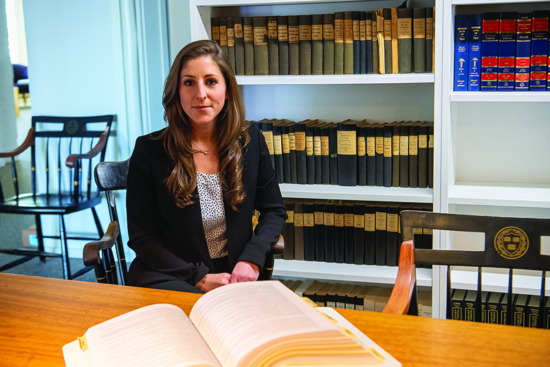 Jess Bullock in a law office library