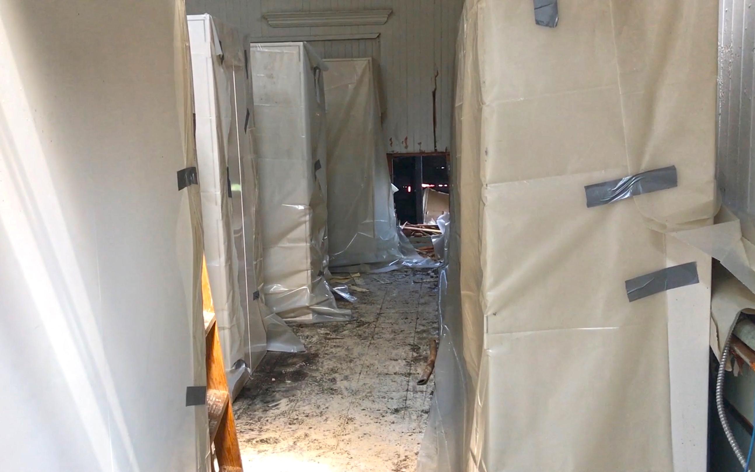Torrey Hall Cabinets under tarp
