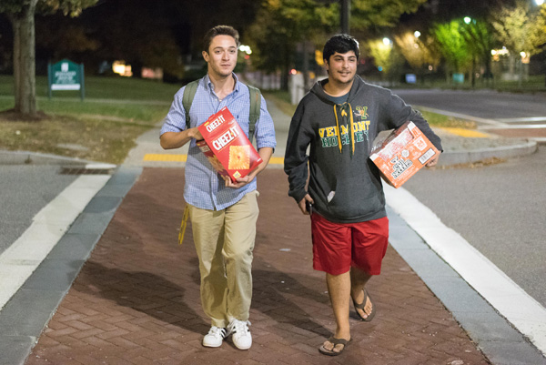 Students with boxes of snacks