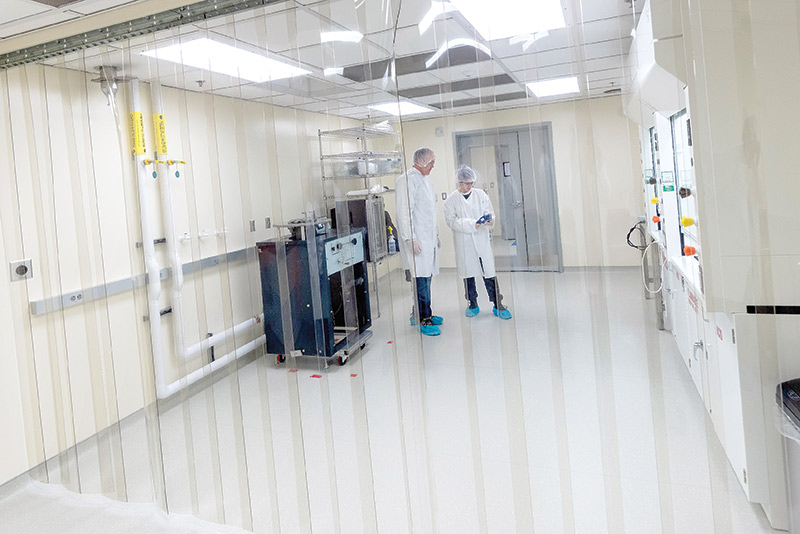Student and professor working in the clean room in Discovery Hall