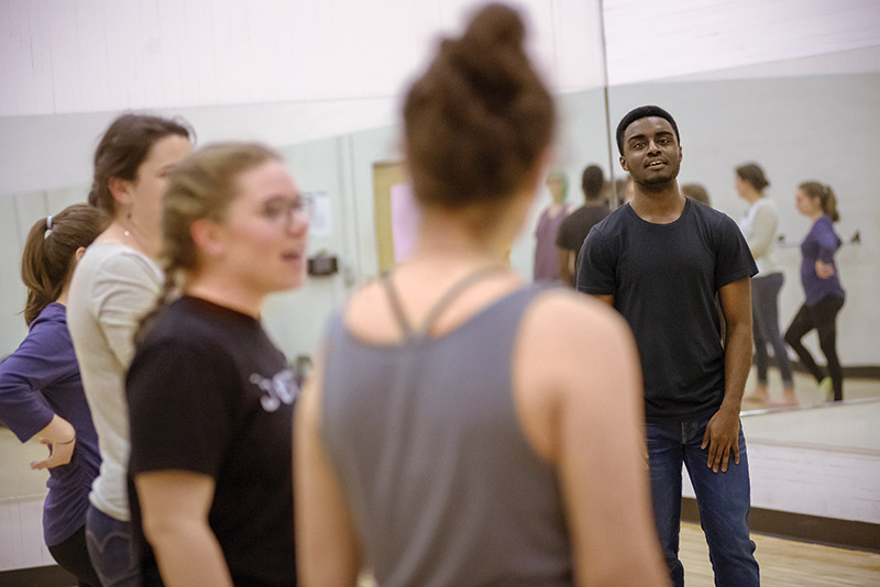 Kwasi Efah in the dance studio with other dancers