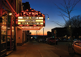 Flynn Theater marquee lit up at night,