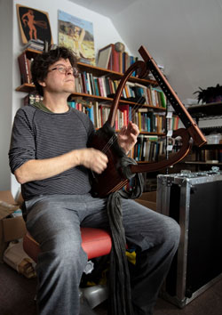 Photo of John Franklin playing the electric lyre crafted by Creston Lea