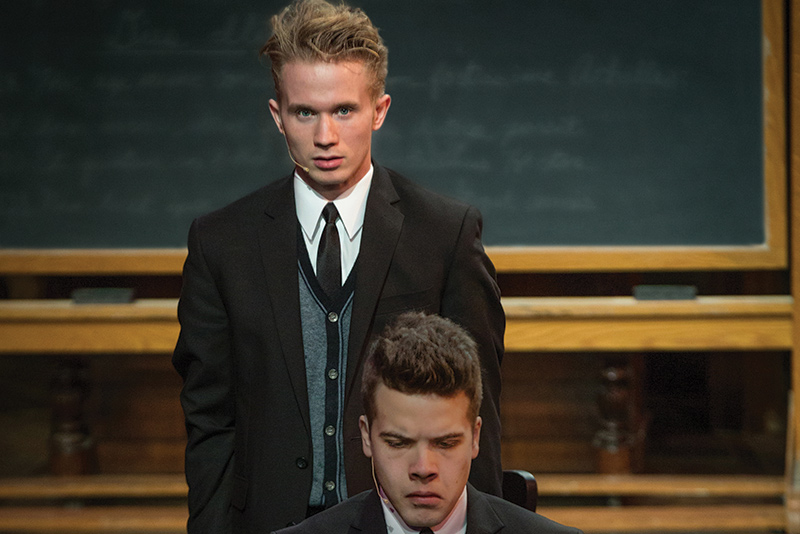 Jay Hayden and another actor on stage in the play Spring Awakening