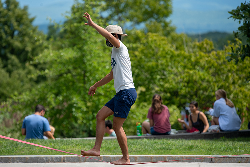 First year student walks on a slackline