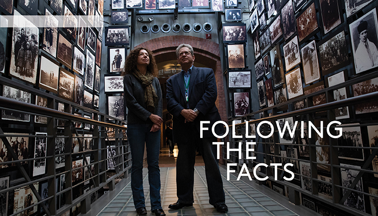 Susanna Schrafstetter  and Alan Steinweis standing in the hall of portraits at the Holocaust Museum.