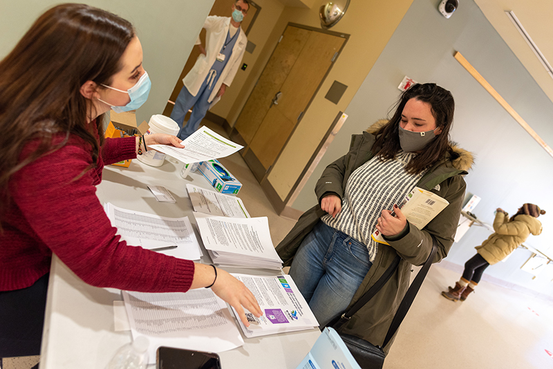 Nursing student Nicole Sampson greets healthcare workers at COVID vaccine clinic