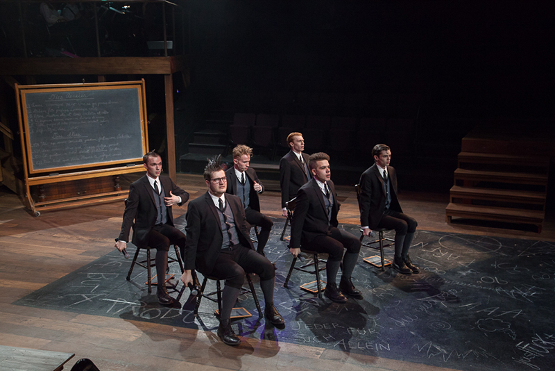 Jimmy Hayden on stage with actors at the University of Vermont