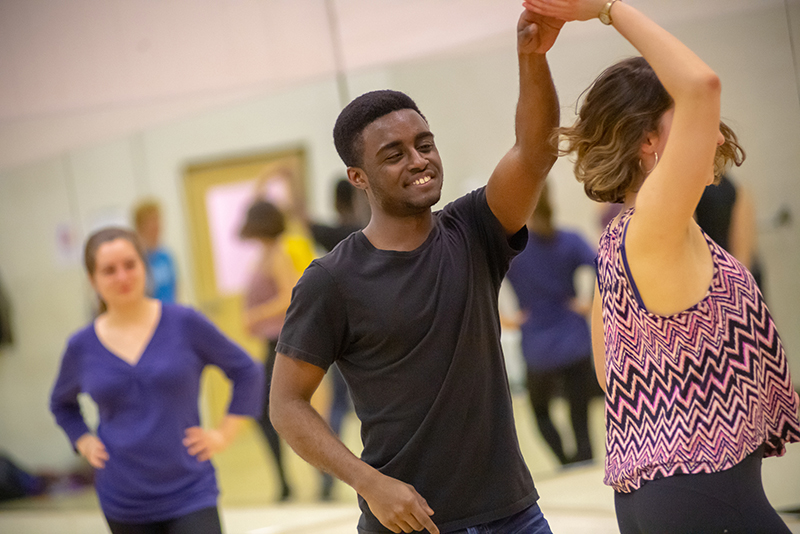 Kwasi Efah, UVM student, dances with Salsa Club