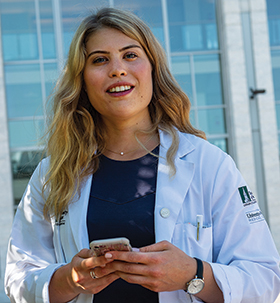 med student anna lidofsky in front of hospital