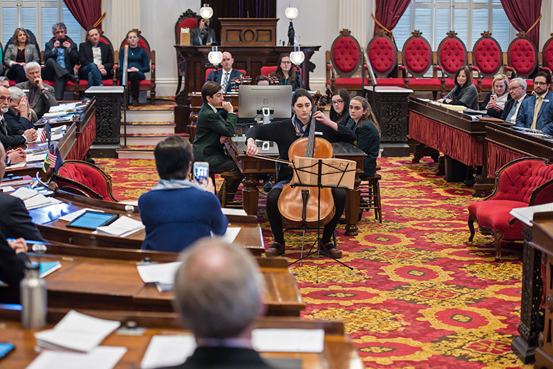 Lucy Rogers plays cello in Vermont State House by Glenn Russell
