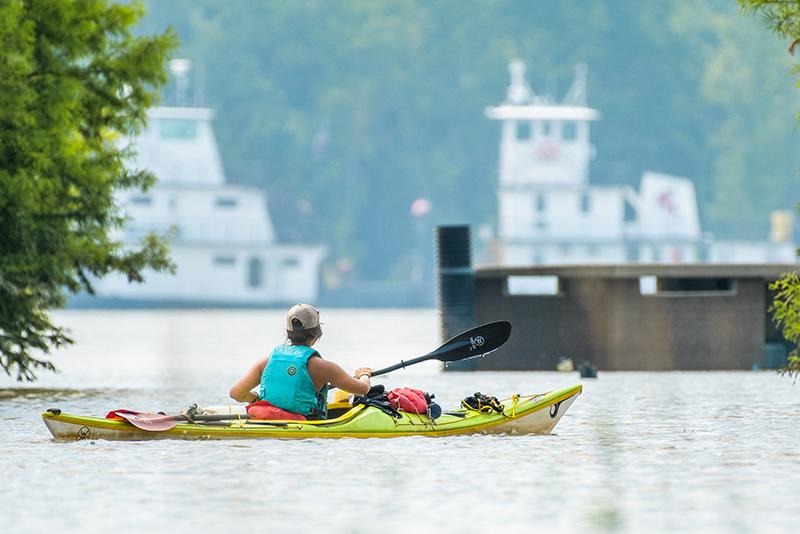 Maya Dizack paddles on the Mississippi