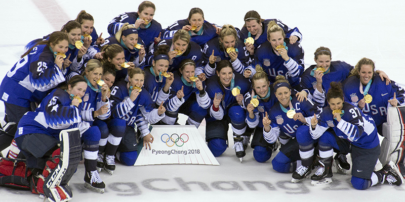 The US Women's Hockey Team with Olympic Gold Medals