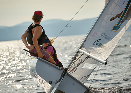Two students sailing a UVM sailing team boat on Lake Champlain